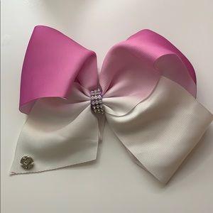 Purple and white Jojo Siwa bow